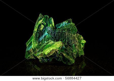 Malachite Mineral Stone In Front Of Black