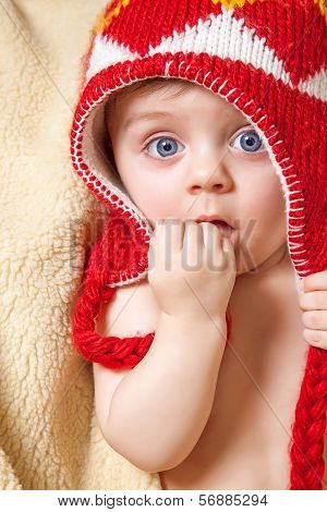 Baby In Red Bonnet
