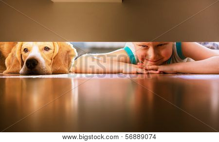 Boy With Doggy Friend Looks Under The Bed