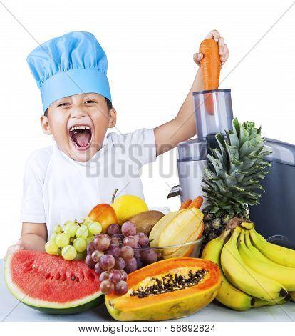 Little Boy Making Fruit Juice