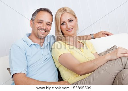 Loving Couple Relaxing On A Sofa