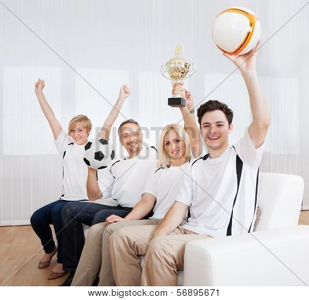 Ecstatic Family Celebrating A Win