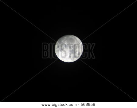 Moon Ascending Into Night Sky
