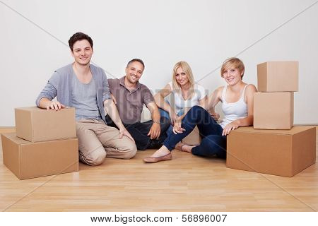 Happy Family Moving Into The New Home