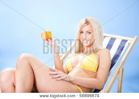 Beautiful Young Woman In Bikini Applying Suncream