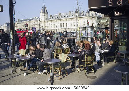 PARIS, FRANCE - MARCH 3, 2013: Parisian street cafe during winter / early spring. Saint Severin on the Boulevard Saint-Michel, 6th arrondissement, left bank of the Seine