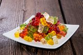 picture of jelly babies sugar  - Gummi Bears on a plate as meal with fork  - JPG