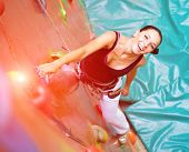 pic of climbing wall  - women climbing on a wall in an outdoor climbing center - JPG