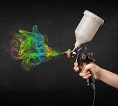 picture of airbrush  - Painter working with airbrush and paints colorful paint concept - JPG