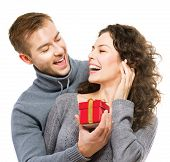 Valentine Gift. Happy Young Couple with Valentine's Day Present isolated on a White background. Happ