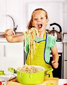picture of pinafore  - Children  eating spaghetti at kitchen - JPG