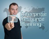 foto of enterprise  - Young man press digital Enterprise Resource Planning button on interface in front of him - JPG