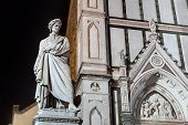 stock photo of alighieri  - statue of italian poet Dante in front of Santa Croce cathedral in Florence Italy - JPG