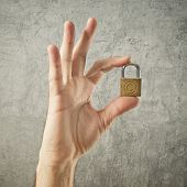 Hand Holding Padlock With Copyright Symbol