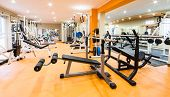 stock photo of health center  - Interior view of a gym with equipment and weights - JPG