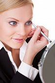 Attractive Businesswoman Drawing With Eyeliner
