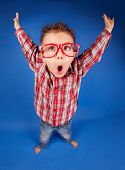 stock photo of misbehaving  - Active funny five years old boy with expressive face - JPG