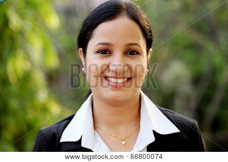 Smiling young business woman at outdoors