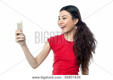 Amused Girl Clicking A Selfie
