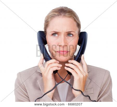 Stressed Businesswoman Tangled Up In Phone Wires