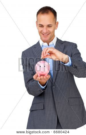 Charismatic Businessman Saving Money In A Piggybank