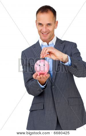 Confident Businessman Saving Money In A Piggybank