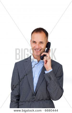 Smiling Businessman Tangled Up In Phone Wires