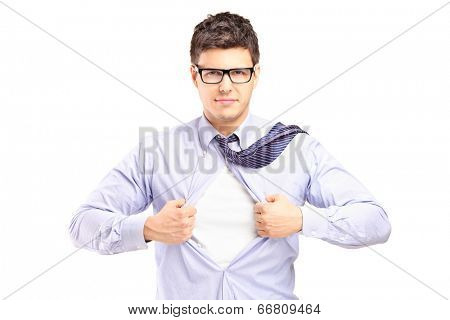 Handsome superhero tearing his shirt isolated on white background