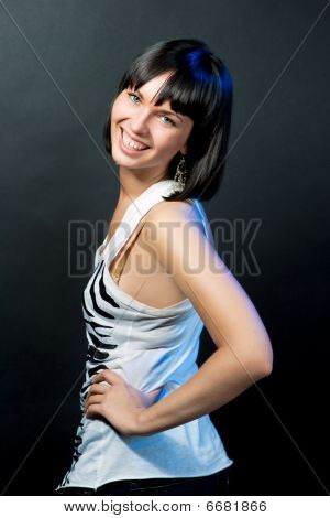 serene sincere caucasian girl smiling isolated on gray