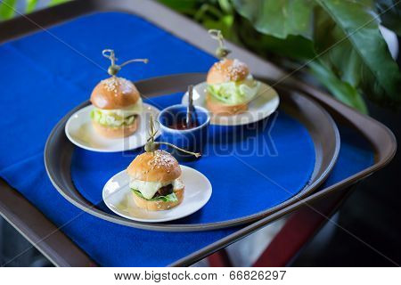 Delicious Mini Burger Canapes On A White Plate