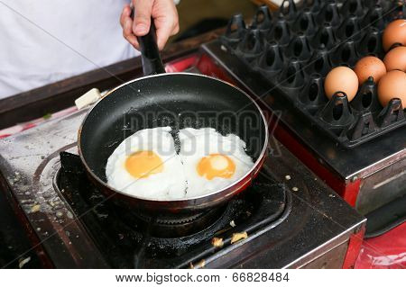 A Chef Is Cooking Sunny-side Up Eggs