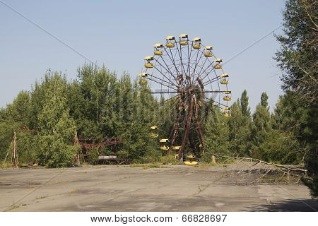 Ferris wheel in Pripyat - abandoned city near Chernobyl nuclear reactor. Whole city was abandoned after nuclear disaster on 26.04.1986