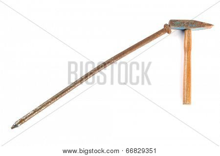 Small rusty hammer and big rusty nail