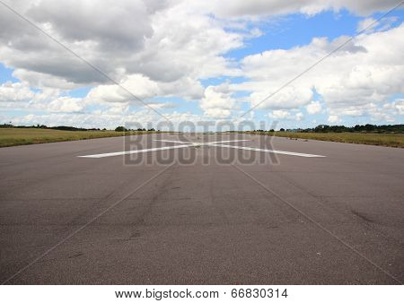 Empty Airplane Runway With White Cross