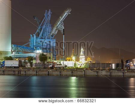 Crane Of An Oil Mill At Night