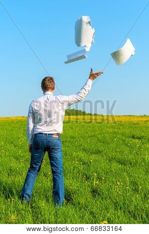 Businessman Throwing Documents Into The Wind