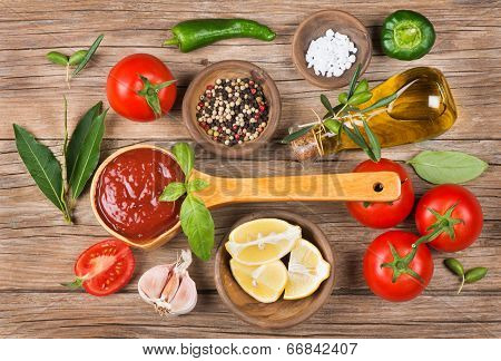 Olive Oil, Vegetables And Spices On A Brown Background