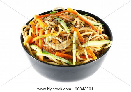 Serving Of Spaghetti With Carrots And Zucchini And Soy Sauce And Sesame Black