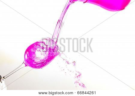 Filling glass with pink fluid