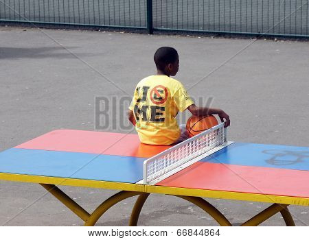 Boys sit on a table tennis table