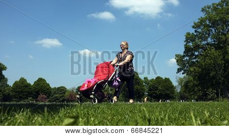 Grandma pushing a pushchair