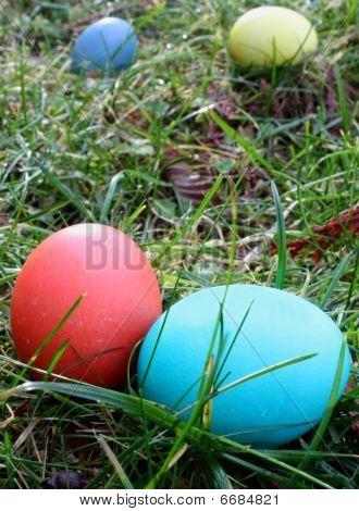 Four Easter eggs, two close, two in background
