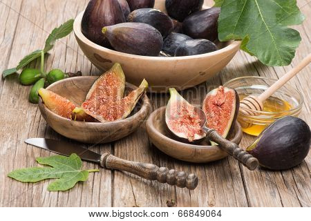 Fresh Figs Fruits On Wooden Plates Over Wooden Table