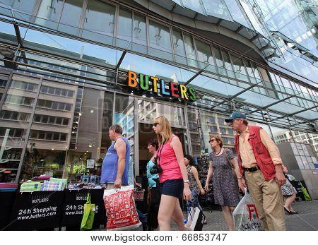 BERLIN, GERMANY - JUNE 11, 2014: Pedestrians walk past a Butlers home accessories store in  Berlin, Germany, on Saturday, June 11, 2014