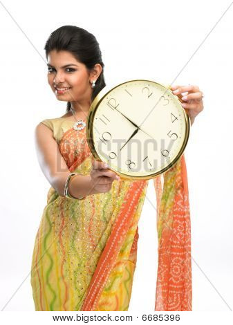 woman showing the clock