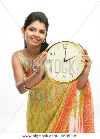 Young girl with the clock