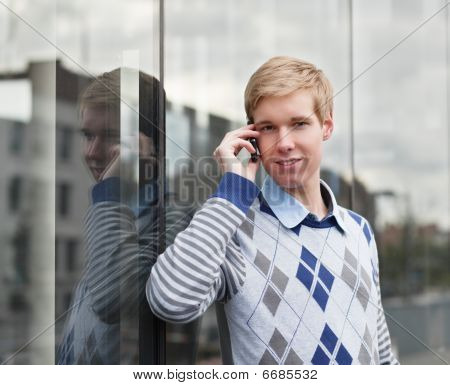Handsome Young Man With Cellphone