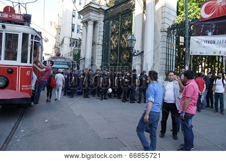 Police In Riot Gear Await Orders During A Protest Demonstration