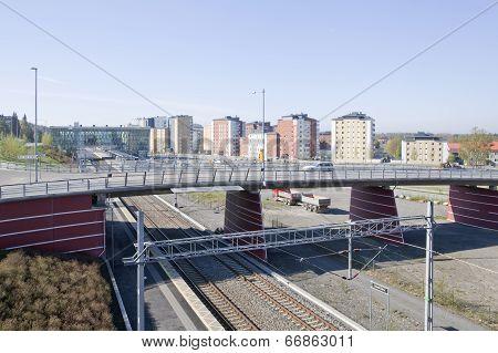 Modern bridge crosses a railway, railroad.