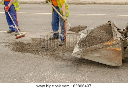 Worker Operating Asphalt During Road Works